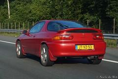 1995 Mazda MX-3 1.8 V6 (NielsdeWit) Tags: nielsdewit car vehicle driving jtvz53 a12 highway snelweg mazda mx3 18 18i 18i24v v6 red 1995