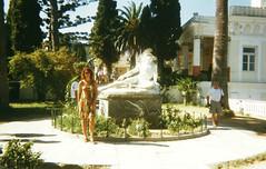 achil99c (Regine G.) Tags: achillion corfu vacations youngwoman sunny trees statue