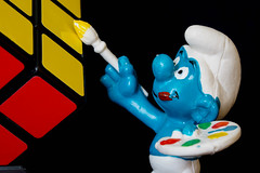 Painter smurf (johnny.mignot) Tags: blue red black macro toys klein artist brush tiny cube drawer smurf jouet yello mondays rubiks petit artiste maler pinsel stroumpf pinceau schlupf portrait fun amusement figurine spass figur jouets spielzeuf naturallight lumièrenaturelle kunstlichtlos childhoodtoys macromondays miniature