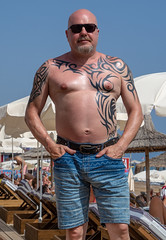 Side, Turkey, May 2019. . . (CWhatPhotos) Tags: cwhatphotos flickr pics picture pictures photo photos photographs foto fotos with that have which contain look like art artistic view views camera olympus micro four thirds sunny day holidays holiday turkey side turkish may 2019 hot sun blue sky skies gorgeous tattooed tattoo inked tattoos male tatts man tribal torso denim denimshorts shorts upperbody seminaked semi naked