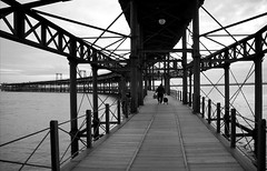 (cherco) Tags: huelva lonely light luz solitario solitary silhouette silueta shadow man blackandwhite blancoynegro lineas bridge vanishingpoint monochrome markiii sea street metal architecture arquitectura composition canon city ciudad alone urban