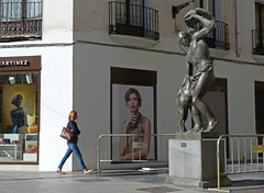 """""""Don't move!"""" (Andy WXx2009) Tags: landscape outdoors style statue landmark feature building advertising girl poster bags people zaragoza spain europe woman walking candid streetphotography artistic shopping urban city store windows espana fashion femme senorita"""
