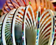 "Childhood Toys ""Slinky Magic"" MM (seanwalsh4) Tags: macromondays hmm slinkymagic macrophotography childhoodtoys seanwalsh spirals 10062019 love peace lovepeace happy"
