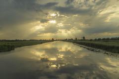 Reflections-12 (niekeblos) Tags: kinderdijk thenetherlands mills water sky reflection clouds reed meadow sunset sundown