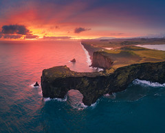 Midnight Sun at Dyrholaey (Iurie Belegurschi www.iceland-photo-tours.com) Tags: dyrholaey midnightsun adventure arctic aerial aerialphotography beautiful beach cloudy clouds coastal cliff daytours dji djimavicpro2 earth extremeterrain fineartlandscape fineart fineartphotography fineartphotos finearticeland guidedphotographyworkshops guidedphotographytour guidedtoursiniceland icelandphototours iuriebelegurschi iceland icelandic icelanders icelandphotographyworkshops icelandphotographytrip icelandphotoworkshops landscape landscapephotography landscapes landscapephoto landscapephotos landofthemidnightsun nature outdoor outdoors ocean phototours phototour photographyiniceland photographyworkshopsiniceland summer sky sunrise seascape sea tours travelphotography travel tripsiceland view workshop workshops water southcoast vik promontory