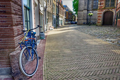 Blue Bike (Alfred Grupstra) Tags: bicycle street urbanscene europe city architecture cobblestone old outdoors town citylife buildingexterior sidewalk brick netherlands alley transportation history nopeople cycling bike blue