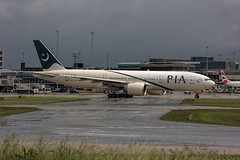 AP-BGY (Steve Perry B) Tags: pia b777 b772 manchester pk taxiing wet