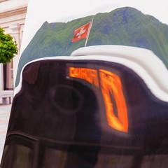 Mirrored Bus (Bephep2010) Tags: 2019 7markiii alpha berg bus fahne frühling ilce7m3 lugano reflektion sel24105g schweiz skulptur sony spiegelung switzerland tessin ticino flag gespiegelt mirrored mountain reflection sculpture spring ⍺7iii kantontessin