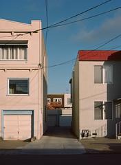Sunset District, San Francisco, California (bior) Tags: pentax645nii pentax645 pentax 645 mediumformat 120 sanfrancisco sunsetdistrict portra160nc expiredfilm kodakportra house townhouse shadow rowhouse powerlines alley garage sutrotower