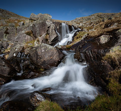 Blue sky, white water (paullangton) Tags: waterfall sky wales snowdonia ogwen ogwenvalley rocks green contrast river landscape canon lee nature