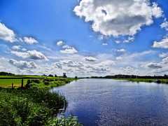BANNFOOT WITH CLOUDS ON THE BANN RIVER ENTERING LOUGH NEAGH IN NORTHERN IRELAND (Monkiiiey Henry Clark) Tags: bannfoot with clouds on the bann river entering lough neagh in northern ireland