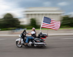 Speed and Honor (kipsnaps) Tags: rolling thunder washington dc motorcycle flag lincoln memorial blur