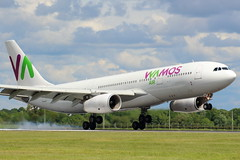 Wamos Charter (EC-LNH) (Fraser Murdoch) Tags: wamos vamos air airbus a330200 a330 330 332 a332 eclnh runway 23 thomas cook airlines mt tcx charter orlando delayed heavy aircraf widebody fraser murdoch canon eos 650d mco kmco egpf gla glasgow international airport cloudy summer schedule long haul plane spotting smoke landing land late manchester position ferry flight positioning