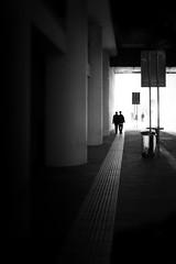 Exit Through You (parenthesedemparenthese@yahoo.com) Tags: dem 2019 bn city couple gare monochrome nb noiretblanc parma parme silhouettes street tunnel april avril blackandwhite bnw byn canon600d colonnes columns ef24mmf28 grandcontraste highcontrast italia italie mur pavement printemps spring station stazionne streetphotography