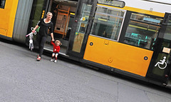 Berlin (kirstiecat) Tags: berlin germany bus people mother child movement cinematic diagonal moment kid street canon