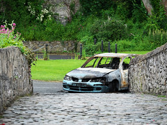 (turgidson) Tags: car abandoned burned out fire joyride nissan almera hatchback gutted destroyed bridge old cobblestones panasonic lumix dmc g9 panasoniclumixdmcg9 panasonicg9 micro four thirds microfourthirds m43 g lumixg mirrorless x vario 35100mm 35100 f28 hhs35100 telephoto zoom lens panasonic35100 panasoniclumixgxvario35100mmf28 silkypix developer studio pro 9 silkypixdeveloperstudiopro9 raw p1000762