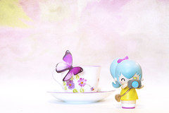 pixie loves tea cups (rockinmonique) Tags: momiji doll mini tiny pixie teacup butterfly texture highkey pink blue yellow girly pretty whimsical moniquewphotography canon canont6s tamron tamron45mm copyright2019moniquewphotography