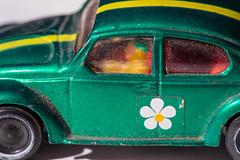 marx vw beetle (jlodder) Tags: macromondays childhoodtoys marx vw beetle green metal metallic flowerdecal racingstripe yellow dusty