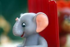 Dumbo du Manège enchanté (Christian Chene Tahiti) Tags: macromondays childhoodtoys canon 6d paea tahiti manègeenchanté eléphant animal texasinstruments jeu game rouge gris rose vert couleur colour hmm macro bokeh closer closeup blanc