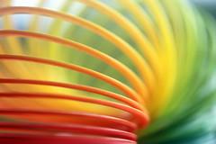 Bracelet arc-en-ciel (Christian Chene Tahiti) Tags: macromondays childhoodtoys canon 6d bracelet arcenciel rainbow jeu game rouge vert jaune orange multicolore colorful couleur colour hmm macro paea tahiti bokeh closer closeup