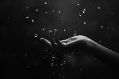 When it rains (NoelleBuske) Tags: rain droplets water hand fingers details motion raining blackwhite blackandwhite monochrome outdoor catching