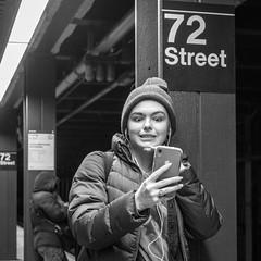 72 Street (John St John Photography) Tags: streetphotography candidphotography 72ndstreetsubwaystation mta newyorkcity newyork selfie thedakota centralparkwest youngwoman mobile phone smartphone bw blackandwhite blackwhite blackwhitephotos johnstjohnphotography