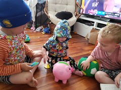 Playing with the piggy bank (quinn.anya) Tags: sam paul eliza kindergartener preschooler brother sister playing toddler pig toy