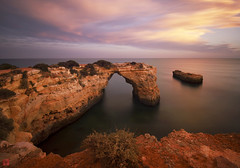 Timeless Beauty (汤Pei) Tags: portugal beach albanderia rock arch sunset ocean clouds