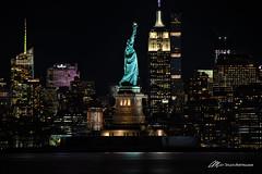 Mr. and Mrs. New York (Matt Straite Photography) Tags: statue statueofliberty lady ladyliberty new york newyork empire skyline sky line buildings skyscraper zoom color night dark lights