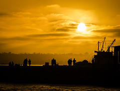 Bathed with gold (Rabican-BUSY) Tags: sunset silhouette golden sun summer sandiego california dark clouds sky people boat ocean bay traveling contrast