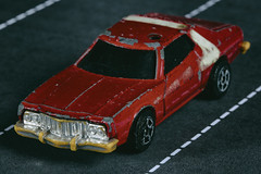 Driving down the imaginary highway -[ HMM ]- (Carbon Arc) Tags: macromondays childhoodtoys imaginary make believe car scale model starskyhutch stripedtomato corgi ford grand torino 1975 collector toy plaything automobile replica highway motorway television program show movie