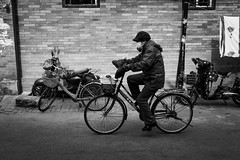 Alley rider (Go-tea 郭天) Tags: pékin républiquepopulairedechine beijing hutong ancient history historical historic alley narrow old transportation transport traditional tradition bicycle bike ride riding rider cold winter lady mask masked move moving movement through hat gloves protected protection bikes bicycles motorbike motorcycle alone lonely woman wall bricks lines street urban city outside outdoor people candid bw bnw black white blackwhite blackandwhite monochrome naturallight natural light asia asian china chinese canon eos 100d 24mm prime