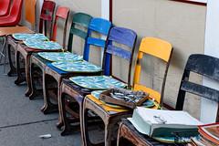 Rainbow Row (fotofish64) Tags: catskill village smalltown downtown urban artsy funky colorful vividcolor chair inarow sidewalk sidewalkdisplay hudsonvalley hudsonvalleyregion greenecounty blue red outdoor antiquestoredisplay newyork pentax pentaxart kmount k70 hdpentaxda1685mmlens streetscape