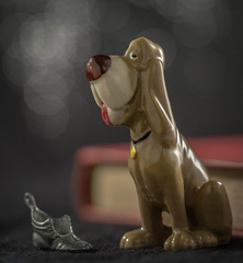 Hector, star of the show (Emma Varley) Tags: childhoodtoy macromondays ceramic animal bloodhound hector imagination creativity bokeh boot book stilllife indoor