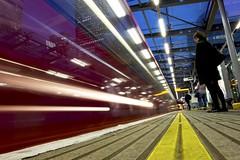 Métro Boulot Dodo (Douguerreotype) Tags: england london dark canarywharf people uk docklands british train lights city britain night gb urban station