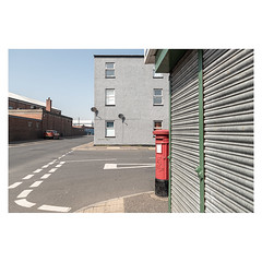 Newcastle Road (John Pettigrew) Tags: lines tamron d750 nikon shutters roads windows topographics space markings documentary shadows mundane yarmouth imanoot banal red walls double patterns postbox great angles yellow johnpettigrew mailbox