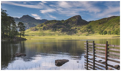 Blea Tarn. (Ian Emerson (Thanks for all the comments and faves) Tags: lakedistrict cumbria bleatarn composition beautiful tarn water calmness fence rocks photography canon6d canon manfrotto gobefilters landscape england greatbritain trees pinetree clouds mountains langdalepikes hiking lakelanddistrict littlelangdale nationalpark 24105 outdoor omot classicview itookit