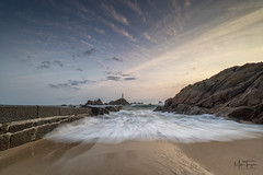 Corbiere tide. (miketonge) Tags: corbiere lighthouse jersey corbierelighthouse tide sea causeway shore waves nikon d850 nisi channelislands