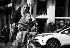 Harder Faster (Photographer : Hans Stellingwerf) Tags: amsterdam streetphotography street nederland netherlands holland mensen people straatmoment straat straatfotografie straatportret streetportrait vrouw woman child kind bike fiets