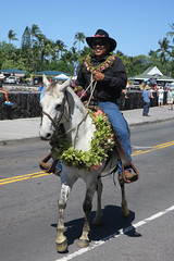 parading paniolo (BarryFackler) Tags: paniolo cowboy kingkamehamehaday horse saddle animal man male kane cowboyhat sunglasses reins holiday parade event celebration smile smiling kona bigisland hawaiiisland westhawaii northkona aliidrive kailuakona hawaii hawaiicounty hawaiianislands hawaiiancukture hawaiianculture lei flowers kingkamehamehadayparade sandwichislands barronfackler barryfackler 2019 polynesia tropical