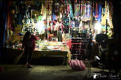 Swept Away (Bright Ideas with Chan Udarbe) Tags: nikond7200 nikonmbd15 sigma1750mmf28exdcoshsm blackrapidrssportversion2 smallrigshoulderbag2208 peakdesignanchorlinksv4 andoerqr60 hoodmanhoodeyeheyensgeyepiece street vendor store stall person lowlight fun flickr night alcala pangasinan philippines