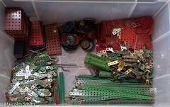 Sorting (M C Smith) Tags: meccano sorting box black blue white clear red green strips girders cylinders round square oblong parts tyres pentax k3 plates axles sails