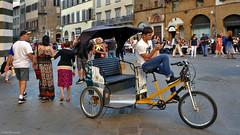 Tuscany: Florence, cycle rickshaw (Henk Binnendijk) Tags: piazzadelduomo florence italy italia italië tuscany toscana toscane people street candid rickshaw cyclerickshaw phone gsm cellphone smartphone bicycle biketaxi velotaxi pedicab bikecab cyclo beca becak trisikad tricycletaxi trishaw
