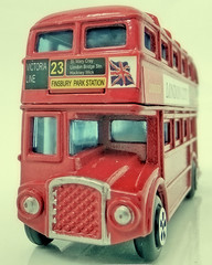 Childhood toys. (karl from perivale) Tags: bus londonbus toy red vehicle indoor macromondays macromonday macro hmm routemaster