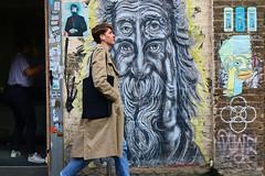 Eyelevel.... (markwilkins64) Tags: art shoreditch bricklane london streetart streetphotography street candid juxtaposition markwilkins eastlondon eyes face artwork streetscene urban walker
