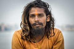 young sadhu (andy_8357) Tags: young sadhu varanasi india man a6000 6000 alpha ilce6000 ilcenex sony canon fd 50mm f14 ganges mother ganga beard long hair sunstreaked serious hindu hinduism penetrating gaze outdoors street portrait portraiture deep