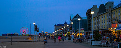Ocean City Boardwalk and Pier at dusk (RPStrick) Tags: leicasummicron50mmf20v leicam262 50mm summicron summicronm oceancity ocean city maryland beach boardwalk pier dusk blue people walking sky kites ferris wheel rides pizza popcorn shops