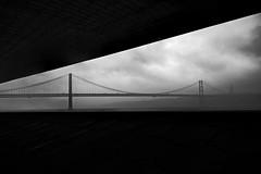 (Sebastian Sighell) Tags: blackandwhite blackwhite monochrome landscape waterscape bridge architecture geometry fog clouds dark lisboa lisbon minimal minimalism minimalist fujifilm portugal