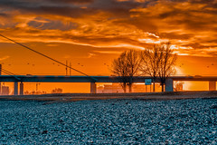 DUESSELDORF, GERMANY - JANUARY 20, 2017: The winter sun goes down over a large bridge and bathes everything in orange warm light (axel-d-fischer) Tags: holl high water abstract dusseldorf gehry cityview office hall warm david scenic docks design rhine chipperfield deutschland range germany medienhafen sundown modern hdr business docklands urban architecture duesseldorf capitalnrw cityscape steven port mediahafen o german frank harbour dynamic