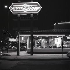 Denver Diner at Night (Chase Hoffman) Tags: film mediumformat 6x6 chasehoffman chasehoffmanphotography hasselblad planar 120film hasselbladc80mmf28tzeissplanar 80mmf28 zeiss denver night hasselblad500 ilford ilfordhp5 hp5 blackwhite bw monochrome blackandwhitefilm blackandwhite